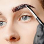Women getting eyebrows tinted