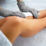 women getting leg waxed